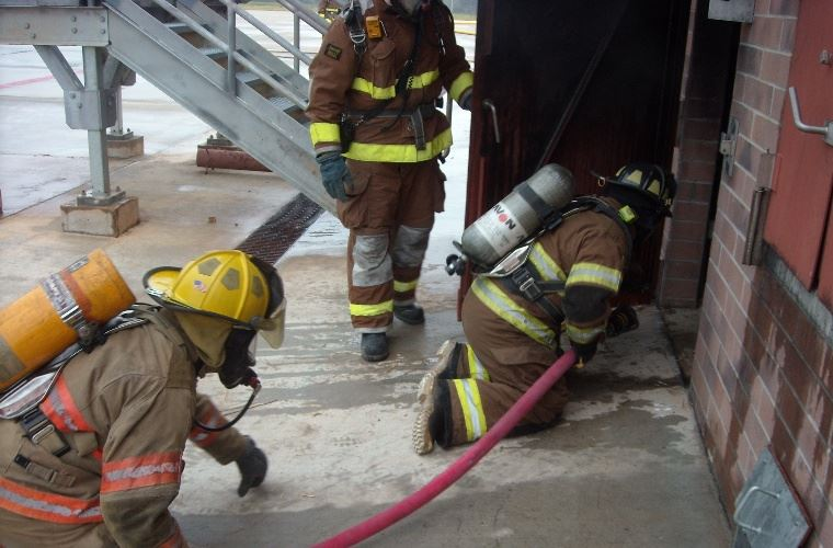 Fire Department Running Drills at Burn Building