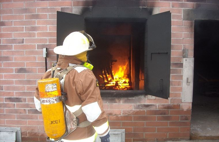 Firefighter Checks Fire at Burn Building